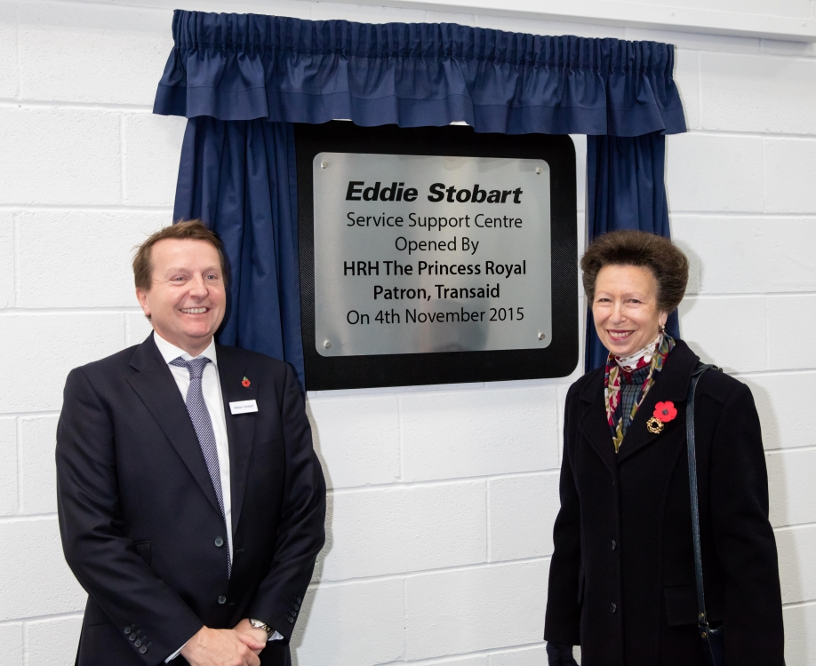 The Princess Royal and William Stobart reveal the commemorative plaque, declaring the Service Support Centre officially open