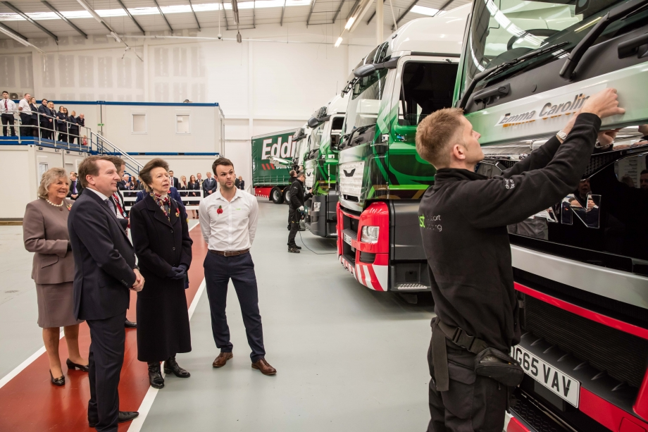 The Princess Royal and William Stobart are shown trucks being wrapped by Gareth Livingstone of AST Transport Branding